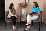 Maria Claudia Marks consulting a client